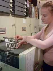 Above: Eve filing an archival holder full of slides.